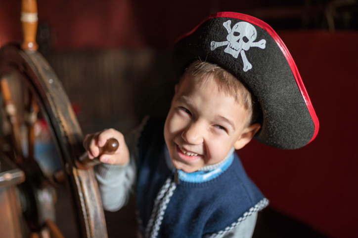 A boy is dressed up as a pirate