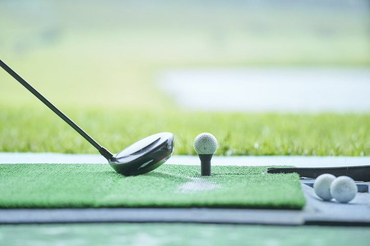 A golfer gets ready to hit a ball at Top Golf