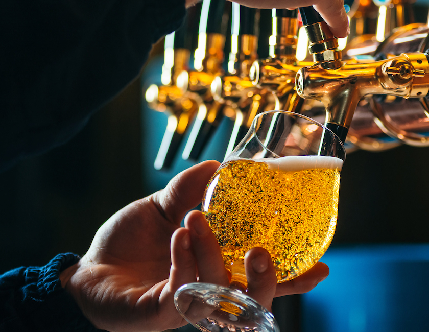 pouring a craft beer from tap